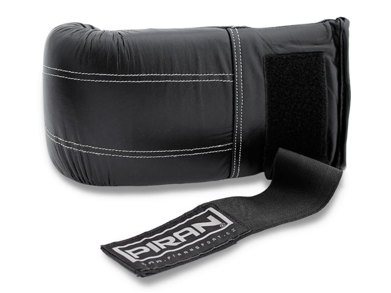 5 cm široký pružný pásek se suchým zipem pro pevné utažení pytlovky kolem ruky a fixaci zápěstí.